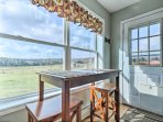 Cozy around the rustic wood table with seating for 2 and enjoy the picturesque views and alpaca herd.
