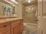 This bathroom offers granite countertops and a large walk-in shower.
