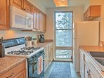 The kitchen has granite counters and state of the art appliances.