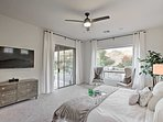 Luxury flourishes throughout the master bedroom furnished with a king bed.