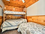 Kids can have their own space in this bunk room that also features a separate twin bed.