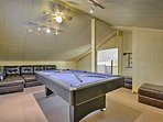 Head upstairs for a lively game of pool on the billiards table!