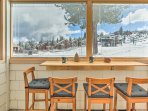 Step out to the porch for a front row seat to watch the skiers.