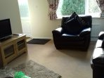 Open plan seating area and TV