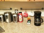 Complimentary coffee and tea await you in the kitchen.