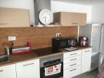 Modern Kitchen - open plan with living and dining area.