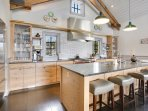 Gourmet kitchen with seating up to four at the breakfast bar