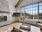 Nestle up by the fireplace, click on the flat screen TV, and be in awe of the views