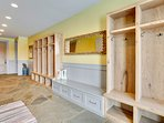 Several cubbies with hooks in the mudroom for storing gear