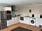 Fully equipped kitchen with self service breakfast supplies, tea/coffee etc.