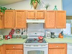 The kitchen features updated appliances and plenty of cabinet storage.
