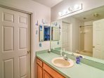 This Jack-and-Jill style bathroom is shared between the third and fourth bedroom.