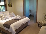 Queen bedroom and two single beds in adjacent room