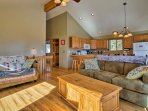 Vaulted ceilings give the living room a feeling of spaciousness.