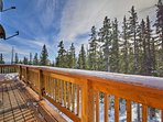 Gaze off of the wraparound deck at the surrounding natural beauty.