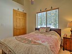 This bedroom is perfect for an additional couple with a cozy queen bed.