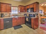 Cooking is a breeze with essential appliances and ample counter space.