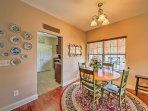 Savor homemade meals at this quaint 4-person dining table.