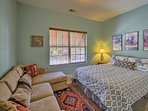 Rest and recuperate in this bedroom furnished with a full bed and couch.