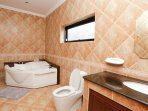 En-suite bathroom for bedroom 1 with a very big jacuzzi including lightning and jets. Also there is