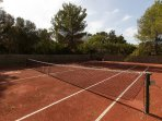 Private tennis court in villa grounds