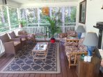 Screened in  deck for your enjoyment!  Cosy space for you to read,relax, bbq,  excellent wi-fi .