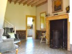 The welcoming main hall, cool in the Summer and warm in the Winter with the wood burning stove