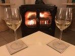 Enjoy a glass of wine in front of the cosy fire in the lounge