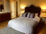 'Indigo' double bedroom with views over the garden. Cosy and comfortable. Located next to the 'dorm'