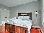 Curl up in this queen bed's silky sheets.