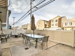 The fenced-in patio is an ideal space to gather with family and friends.
