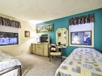 Bedroom 1 includes 2 twin beds with twin trundles.