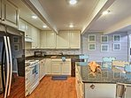 The fully equipped kitchen has stainless steel appliances and granite counters!
