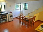 Full kitchen complete with full sized refrigerator, microwave, gas oven and stove.