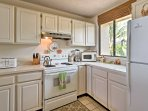 Modern appliances and plenty of counterspace make meal preparations a breeze.