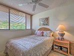 Seek peace and quiet in the second bedroom featuring a queen-sized bed.