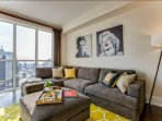 Living room with floor to ceiling window looking South East (lake, CN Tower and Financial district)