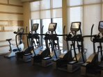 REC floor with indoor whirlpool, yoga studio and a full gym