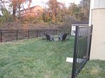 Play with your best friend in a fenced yard