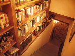 library lining the stairway to the bedrooms. pick up a book to read and relax.
