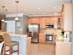 whip up a meal in this fully equipped kitchen with stainless steel appliances!