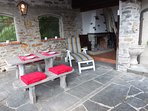 Grottino (terrace) with fireplace and grill to enjoy the meals at any time of the day.