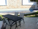 Large fully furnished patio with Webber gas grill.  Just steps from the shallow section of the pool