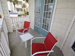 Balcony has beach toys and chairs