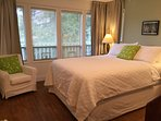 Queen bedroom with 5 windows facing the front yard
