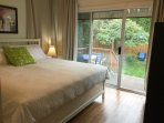 King master bedroom with sliding doors to deck