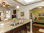 Kitchen open to entire living area allowing for a feeling of openness throughout the condo.