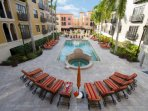 European style courtyard surrounding the resort pool & spa, complete with comfortable chaise lounges and umbrellas.