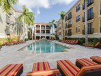 Spend your vacation days relaxing and recharging poolside at The Residences at Coconut Pointe.