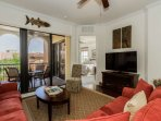 A charming view of the picturesque patio, and a large screen TV with cable complete this living area.